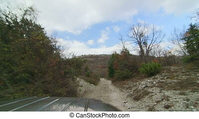Off road driving on stony mountain track POV - Off road...