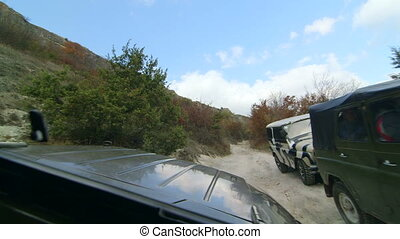 Off-road vehicle on rocky track to Mangup in the Crimean mountains