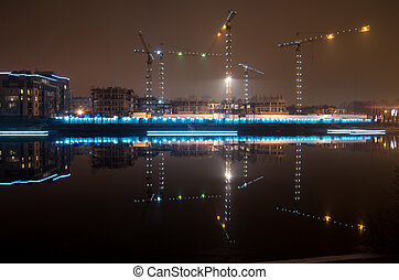 Tower cranes night view from the waterfront Admiral Lazarev