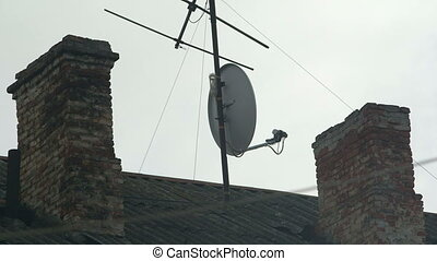 Chimney and home TV antenna on the roof