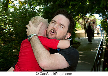 Loving Father Comforts Fussing Son - A loving father...