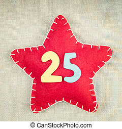 Concept for christmas, red star with wooden numbers 25 on...