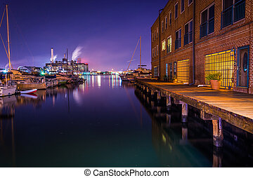 Apartment building and marina at night on the waterfront in...