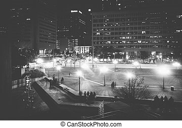 McKeldin Square at night in downtown Baltimore, Maryland.