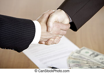 BUSINESS HANDSHAKE AFTER CONTRACT