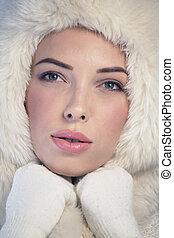 Young woman wearing a fur cap - Young woman wearing a white...
