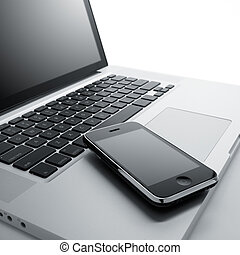 modern technology - laptop computer and mobile phone against...