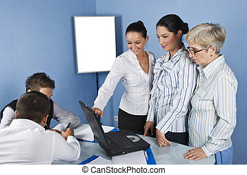 Working team people in office - Three business women using a...