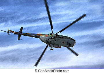 Military helicopter in sky