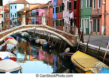 Traditional view of Burano (Venice, Italy). Colored houses,...