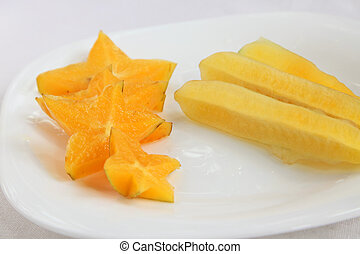 Sliced starfruit, exotic tropical fruit plate arrangement