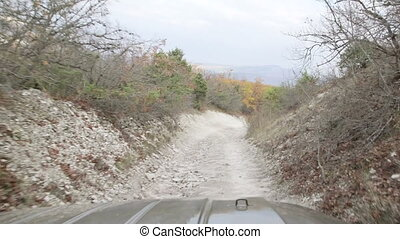 Off road driving on stony mountain track
