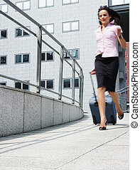 businesswoman in a hurry - business woman rushes out of the...