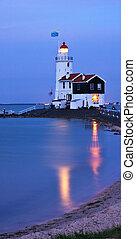 Light in the night - illuminated lighthouse in twilight...