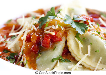Ravioli with a rich tomato sauce, topped with parmesan...