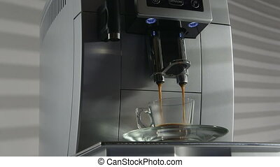 Automatic coffee machine making espresso close-up