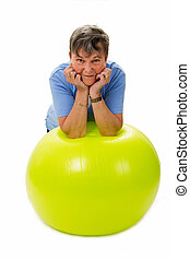 Senior woman with fitness ball