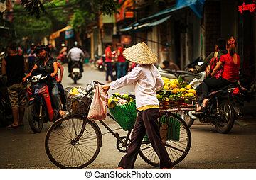 Vietnamese people. Hanoi - street vendor in Hanoi, Vietnam