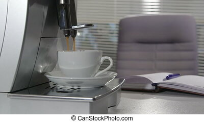 Business person having coffee break with cup of espresso in office