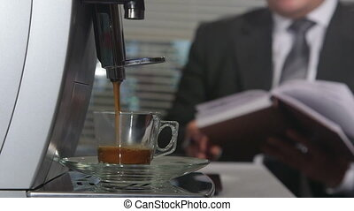 Coffee machine making espresso in office at background business person