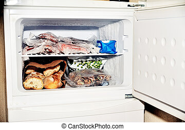 Freezer compartment of a refrigerator containing meat and...