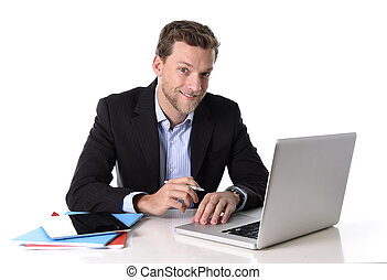 young attractive businessman working happy at computer desk...