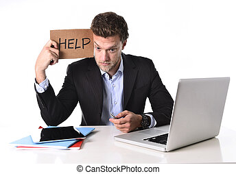 attractive businessman working in stress at computer holding...