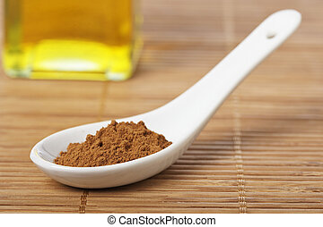 Cinnamon in the spoon and oil bottle for prepare tasty food...