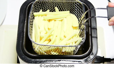 Making homemade french fries in countertop deep fryer