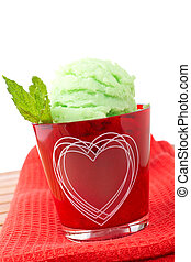 Delicious mint ice cream in red glass bowl Shallow depth of...