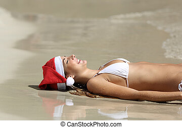 Woman relaxing on the beach on christmas holidays