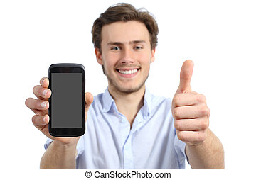 Young man showing a blank smart phone screen with thumbs up...
