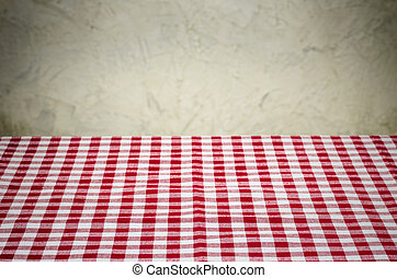 Background with checkered tablecloth and a rustic wall