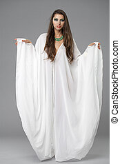 Portrait of the young sexy woman in a white tunic Arabic -...