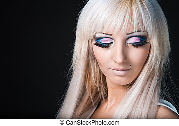 Fashion model with barbie doll make-up