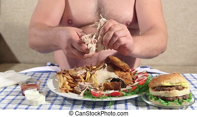 Hungry person eating fat dinner at home