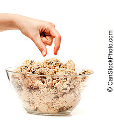 Cookie Dough Taste Test - A hand reaching for a bowl of raw...