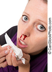 young woman with bleeding nose isolated on white - a young...