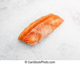 A piece of salmon fillet is on ice