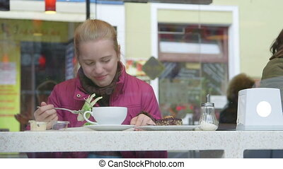 Teenage girls friends enjoying light snack at cafe...