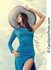 romantic sky - Portrait of a charming lady in beautiful...