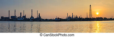 beautiful sun rising scene with oil ,gas refinery industry...
