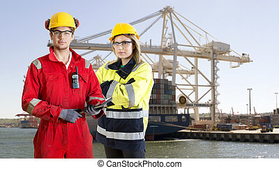 Dockers posing in front of a container ship - Two dockers,...