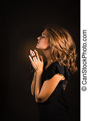 Close up shoot woman hands with rosary in dark background