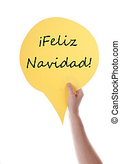 Yellow Speech Balloon With Feliz Navidad - Hand Holding A...