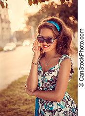 American redhead girl in suglasses. Photo in 60s style.