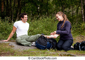 Leg Bandage - A couple camping and putting on a leg bandage
