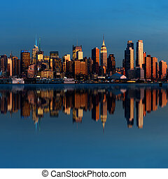 Midtown Manhattan skyline with reflections at dusk panorama...