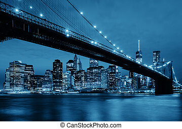 Manhattan Downtown urban view with Brooklyn bridge at night