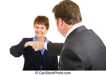 Business Team - Fist Bump - Mature businesswoman giving a...